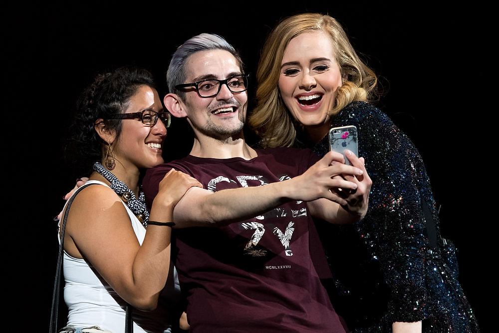 ZURICH, SWITZERLAND - MAY 17: Adele poses for a selfie with two fans on stage at Hallenstadion on May 17, 2016 in Zurich, Switzerland. (Photo by Philipp Schmidli/Getty Images for September Management)
