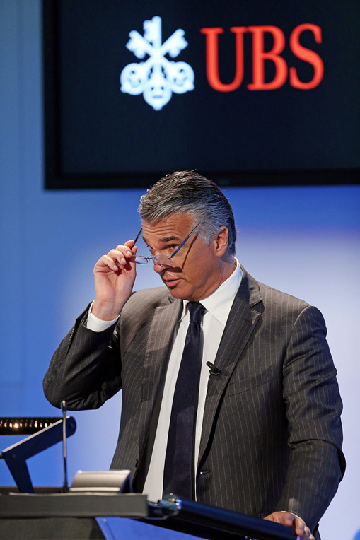 Sergio Ermotti, chief executive officer of UBS AG, adjusts his spectacles as he speaks during a news conference to announce the company's first-quarter financial results in Zurich, Switzerland, on Tuesday, May 6, 2014. UBS, Switzerland's largest bank, reported first-quarter profit that beat analysts' estimates and said it plans a special payout for investors. Photographer: Philipp Schmidli/Bloomberg