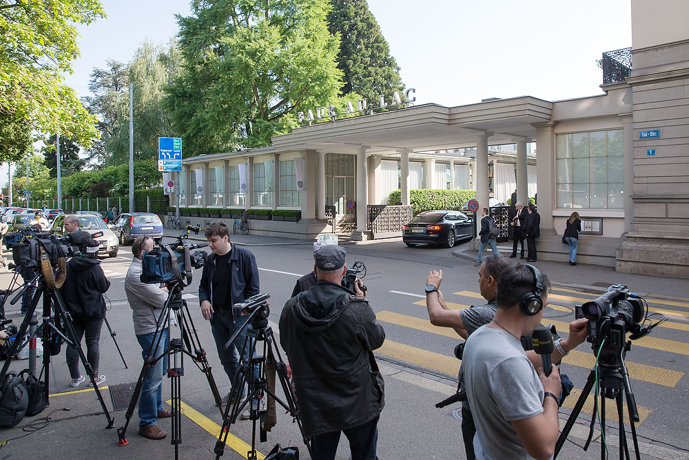 ZURICH, SWITZERLAND - MAY 27: Journalists report in front of the hotel Baur au Lac Zurich in which Swiss police detained top FIFA football officials as part of a US investigation on May 27, 2015 in Zurich, Switzerland. (Photo by Philipp Schmidli/Getty Images)