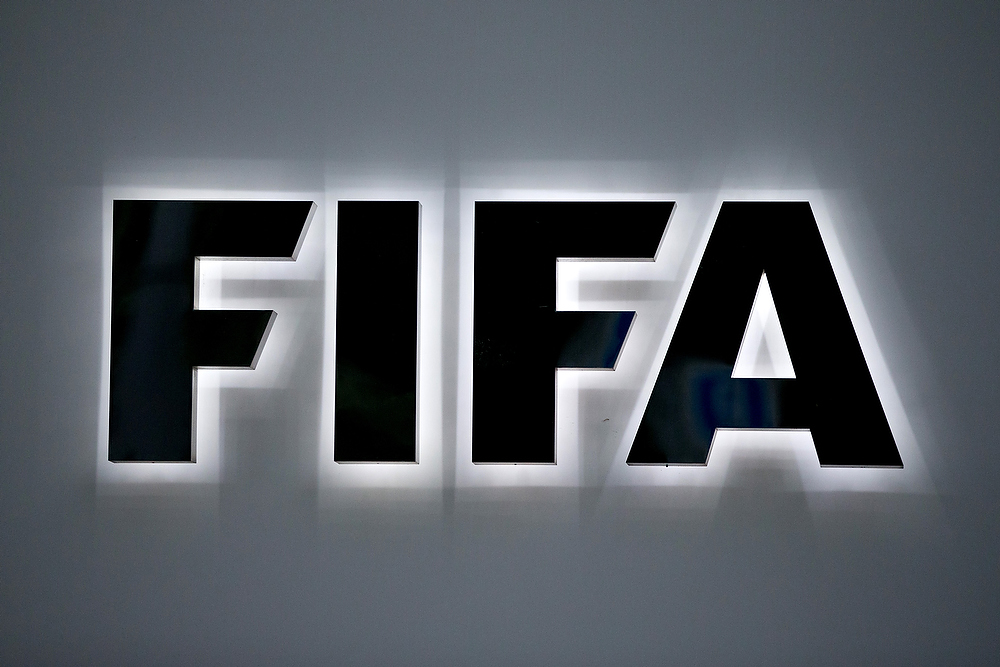 ZURICH, SWITZERLAND - JUNE 02: An illuminated FIFA logo sits on a sign at the FIFA headquarters on June 2, 2015 in Zurich, Switzerland. Joseph S. Blatter resigned as president of FIFA. The 79-year-old Swiss official, FIFA president for 17 years said a special congress would be called to elect a successor. (Photo by Philipp Schmidli/Getty Images)