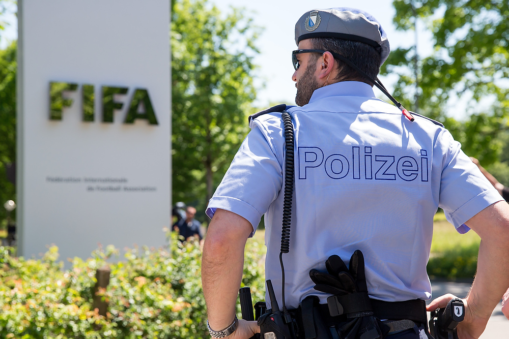 ZURICH, SWITZERLAND - JUNE 03: A policeman stands in front of the FIFA headquarters on June 3, 2015 in Zurich, Switzerland. Joseph S. Blatter resigned as president of FIFA. The 79-year-old Swiss official, FIFA president for 17 years said a special congress would be called to elect a successor. (Photo by Philipp Schmidli/Getty Images)
