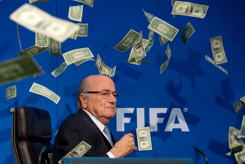 ZURICH, SWITZERLAND - JULY 20: Comedian Simon Brodkin (not pictured) throws dollar bills at FIFA President Joseph S. Blatter during a press conference at the Extraordinary FIFA Executive Committee Meeting at the FIFA headquarters on July 20, 2015 in Zurich, Switzerland. (Photo by Philipp Schmidli/Getty Images)